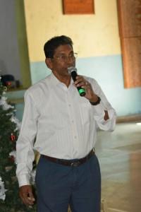 Member Agnelo Fernandes saying the grace before meals