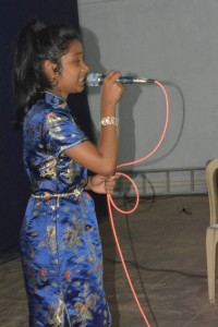 Youngster singing for the elders